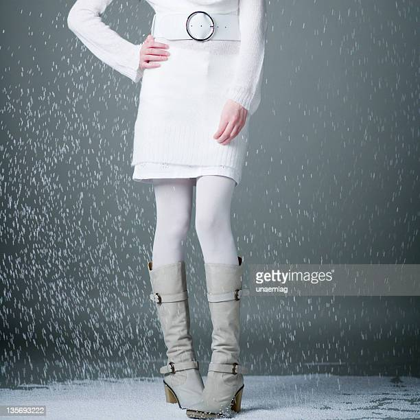 half female body standing up in snow