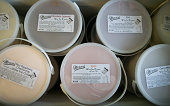 Half gallon cans of wine ice cream sit in a cooler at Mercer's Dairy in Boonville New York US on Friday July 25 2014 Mercer's Dairy ships its...