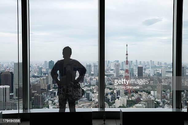 Half invisible person looking at Tokyo city view