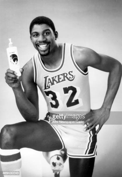 A half length portrait of basketball player Magic Johnson wearing his Los Angeles Lakers no 32 shirt advertising a hair product 1980