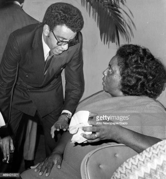 A half length portrait of civil rights leader Fannie Lou Harmer and congressional aide Malcolm Diggs 1965