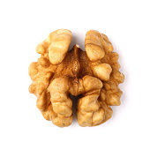 Single half of walnut , isolated on white background, macro shot.