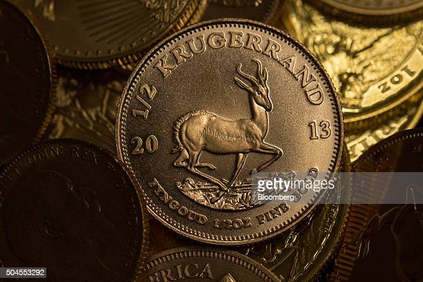 A half ounce 22 carat Krugerrand gold coin sits on display at the Sharps Pixley Ltd gold showroom in this arranged photograph in London UK on Monday...