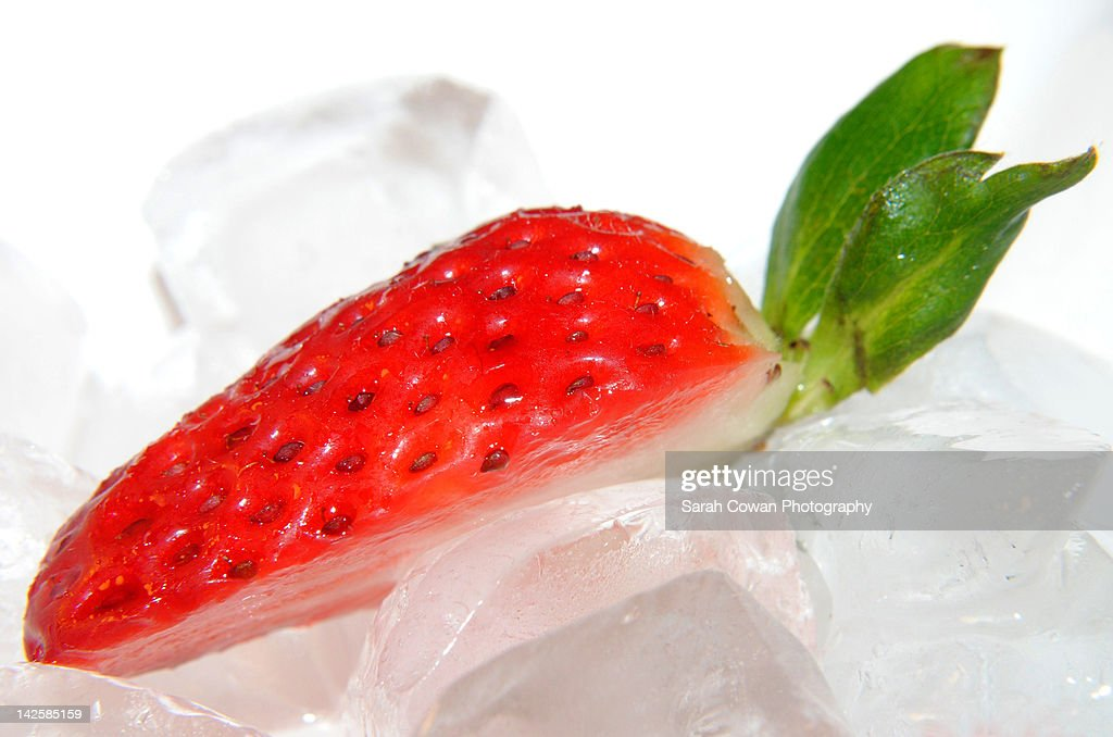 half strawberry resting on stock photo getty images