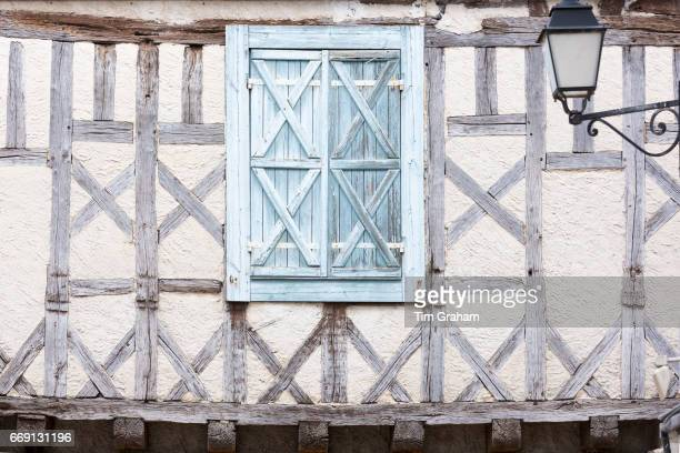 Half timber medieval old architecture and shutters in 13th Century bastide town of Eymet on September 19 2015 in Aquitaine France