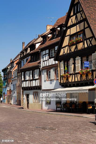 Half timbered buildings along the Quai de la Poissonnerie, Petite Venise (Little Venice), Colmar, Haut Rhin, Alsace, France, Europe