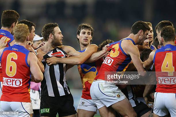 A half time melee breaks out during the round 21 AFL match between the Collingwood Magpies and the Brisbane Lions at Melbourne Cricket Ground on...