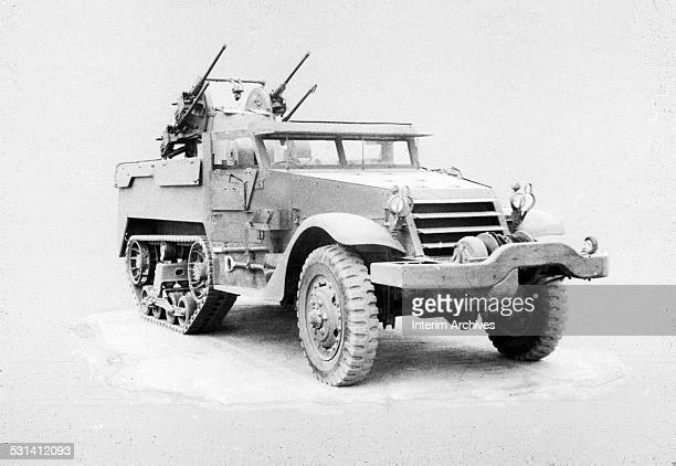 M16 half track with multiple gun antiaircraft motor carriage in rear used by American forces during World War II