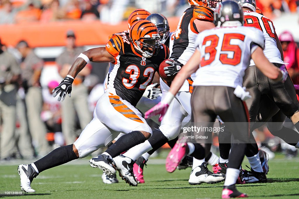 Halfback <a gi-track='captionPersonalityLinkClicked' href=/galleries/search?phrase=Cedric+Benson&family=editorial&specificpeople=204165 ng-click='$event.stopPropagation()'>Cedric Benson</a> #32 of the Cincinnati Bengals picks up yardage against the Tampa Bay Buccaneers at Paul Brown Stadium on October 10, 2010 in Cincinnati, Ohio.