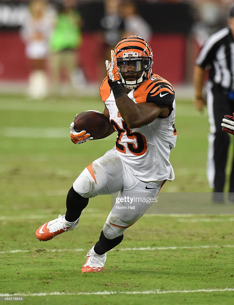 Halfback Giovani Bernard of the Cincinnati Bengals runs with the ball against the Arizona Cardinals during a NFL preseason game at University of...