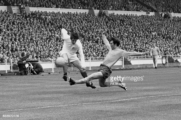 Halfback's Howard Kendall of Everton and Tony Brown in a challenge for the ball