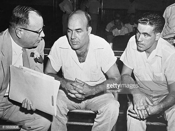 Halfbrothers JW Milam and Roy Bryant confer with attorney Sidney Carlton on murder and kidnapping charges facing them in the death of 14yearold...