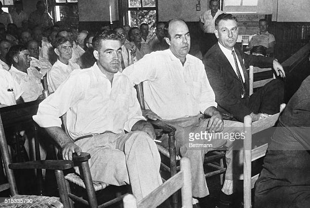 Halfbrothers Roy Bryant and J W Milam sit with an attorney as they go on trial Sept 19th for the murder of 14yearold negro Emmett Till of Chicago The...