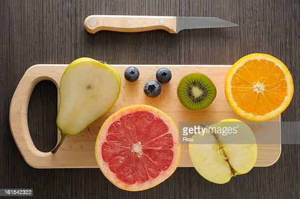Halfed fruits on a choping board