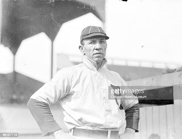 Halflength portrait of an unidentified Philadelphia Phillies baseball player National League standing near grandstand at West Side Grounds Chicago...