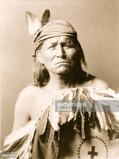 Halflength portrait of Apache man