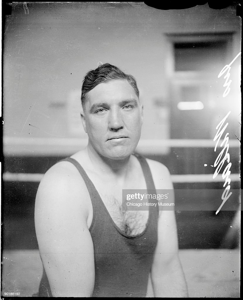 Half-length portrait of pugilist Jess Willard (1881 - 1968) facing the camera, sitting in a boxing ring in a room in Chicago, Illinois, 1912. From the Chicago Daily News collection.