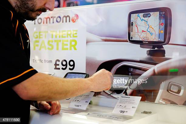 A Halfords employee demonstrates a TomTom Go 5100 navigation system manufactured by TomTom NV inside the Halfords Group Plc store in Manchester UK on...