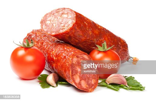 Half-sliced sausage roll, and tomatoes on white background