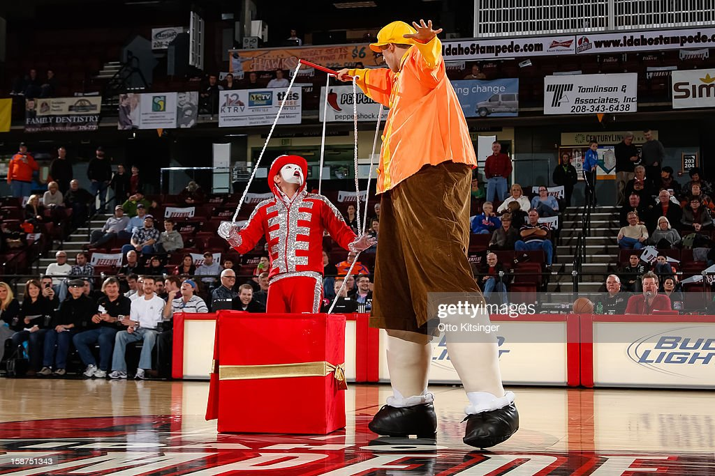 Halftime act 'The Marionette' performs during the NBA D-League game between the Maine Red Claws and the Idaho Stampede on December 26, 2012 at CenturyLink Arena in Boise, Idaho.
