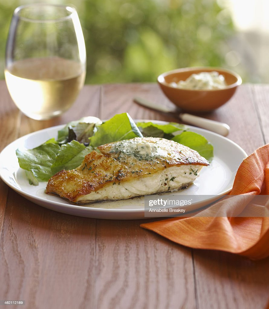 Halibut served with Green Salad and White Wine : Stock Photo