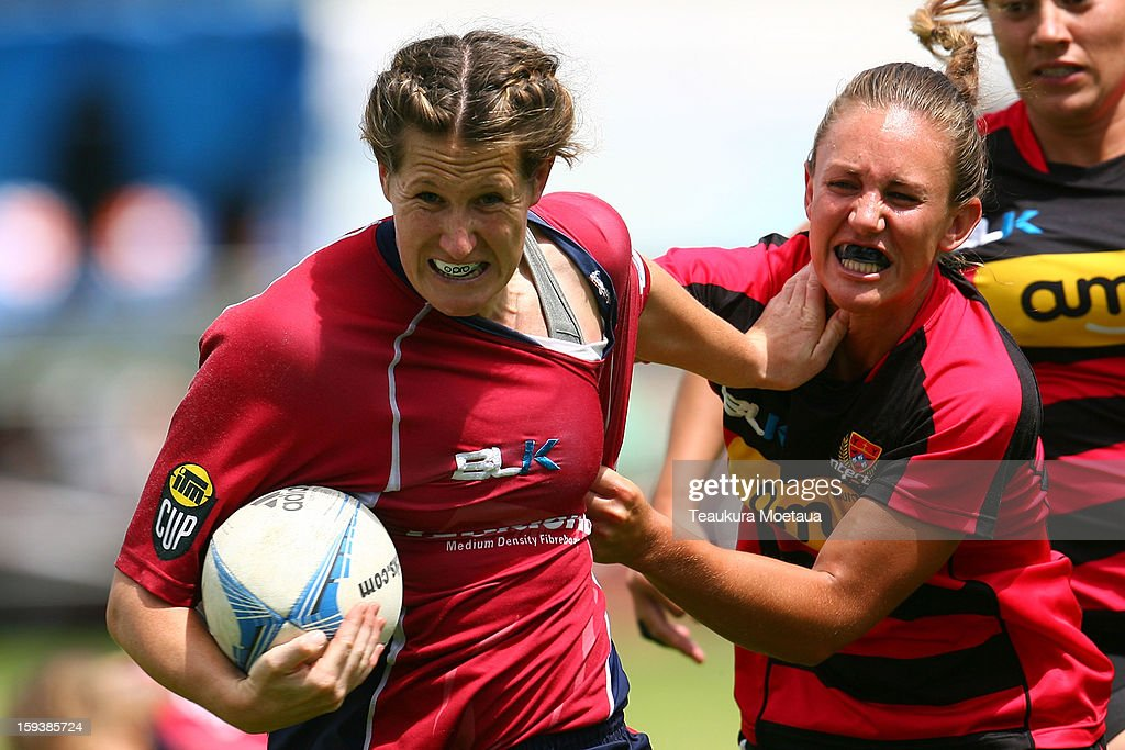 Halie Hurring of Tasman makes a break against Canterbury during the National Rugby Sevens at the Queenstown Recreation Ground on January 13, 2013 in Queenstown, New Zealand.