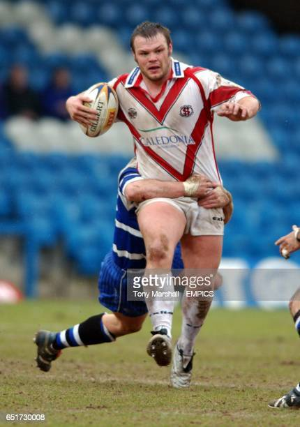 Halifax Blue Sox's Daryl Cardiss tackles St Helens Saints' Keiron Cunningham