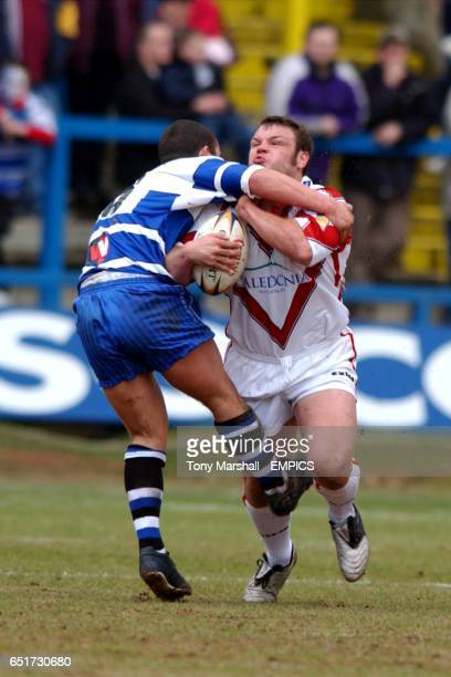 Halifax Blue Sox's Sean Penkywicz tackles St Helens Saints' Keiron Cunningham