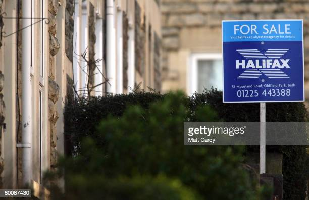 Halifax estate agent's 'for sale' sign is displayed outside a house on March 3 2008 in Bath United Kingdom Banks and building societies in the UK are...