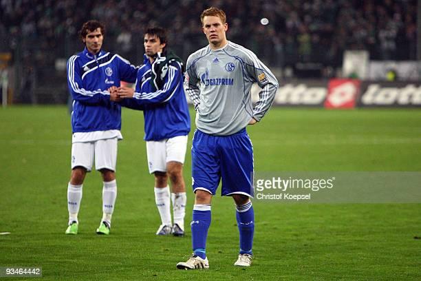 Halil Altintop Jan Morávek and Manuel Neuer of Schalke look dejected after losing 01 the Bundesliga match between Borussia Moenchengladbach and FC...