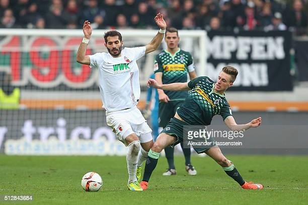 Halil Altintop of Augsburg battles for the ball with Patrick Herrmann of Moenchengladbach during the Bundesliga match between FC Augsburg and...