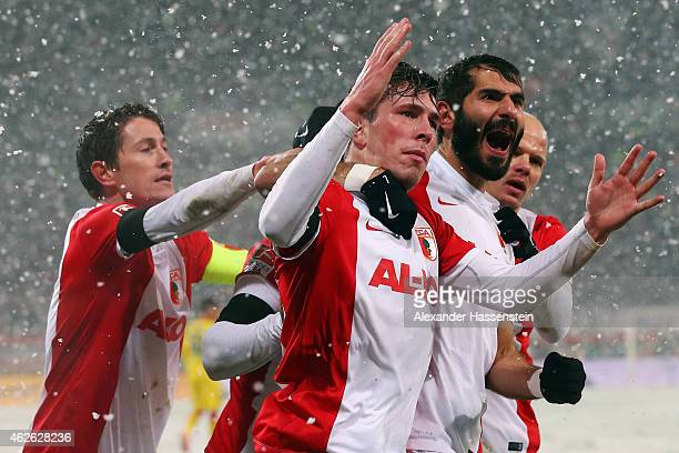 Halil Altintop of Augsburg celebrates his team's first goal with team mates PierreEmile Hojbjerg Tobias Werner and Paul Verhaegh during the...