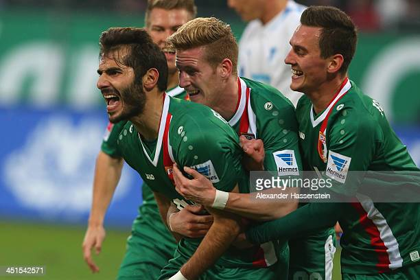 Halil Altintop of Augsburg celebrates scoring the opening goal with his team mates Andre Hahn and Arkadiuzs Milik during the Bundesliga match between...