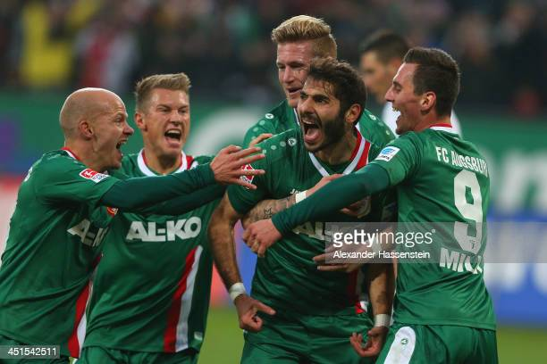 Halil Altintop of Augsburg celebrates scorng the opening goal with his team mates during the Bundesliga match between FC Augsburg and TSG 1899...
