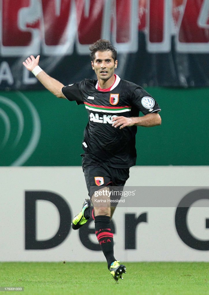 <a gi-track='captionPersonalityLinkClicked' href=/galleries/search?phrase=Halil+Altintop&family=editorial&specificpeople=602238 ng-click='$event.stopPropagation()'>Halil Altintop</a> of Augsburg celebrates the second goal during the DFB-Cup between RB Leipzig and FC Augsburg at Zentralstadion on August 02, 2013 in Leipzig, Germany.