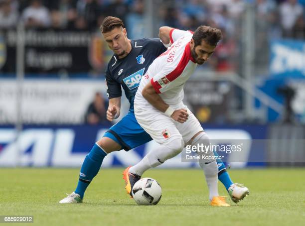 Halil Altintop of Augsburg is challenged by Ermin Bicakcic of Hoffenheim during the Bundesliga match between TSG 1899 Hoffenheim and FC Augsburg at...