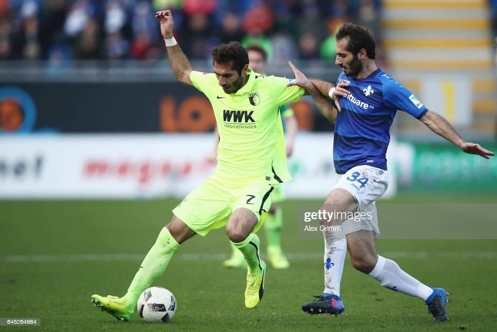 Halil Altintop (L) of Augsburg is challenged by Hamit Altintop of Darmstadt during the Bundesliga match between SV Darmstadt 98 and FC Augsburg at Jonathan-Heimes-Stadion am Boellenfalltor on February 25, 2017 in Darmstadt, Germany.