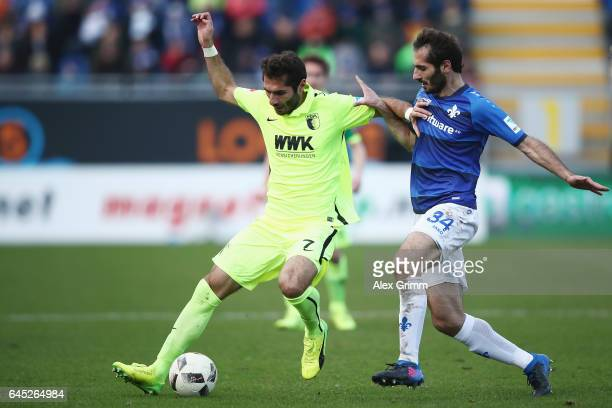 Halil Altintop of Augsburg is challenged by Hamit Altintop of Darmstadt during the Bundesliga match between SV Darmstadt 98 and FC Augsburg at...