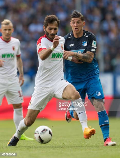 Halil Altintop of Augsburg is challenged by Steven Zuber of Hoffenheim during the Bundesliga match between TSG 1899 Hoffenheim and FC Augsburg at...
