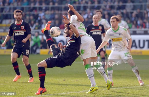 Halil Altintop of Augsburg scores his teams first goal during the Bundesluga match between Borussia Moenchengladbach and FC Augsburg at BorussiaPark...