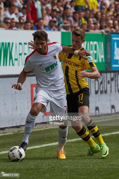 Halil Altintop of Augsburg und Erik Durm of Dortmund battle for the ball during the Bundesliga match between FC Augsburg and Borussia Dortmund at the...
