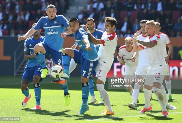 Halil Altintop of FC Augsburg challenges Bobby Wood of Hamburger SV during the Bundesliga match between FC Augsburg and Hamburger SV at WWK Arena on...