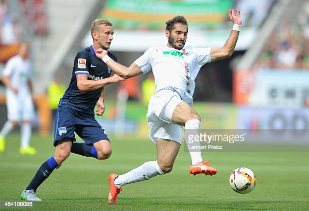 Halil Altintop of FC Augsburg challenges Fabian Lustenberger of Hertha BSC during the Bundesliga match between FC Augsburg and Hertha BSC at WWKArena...