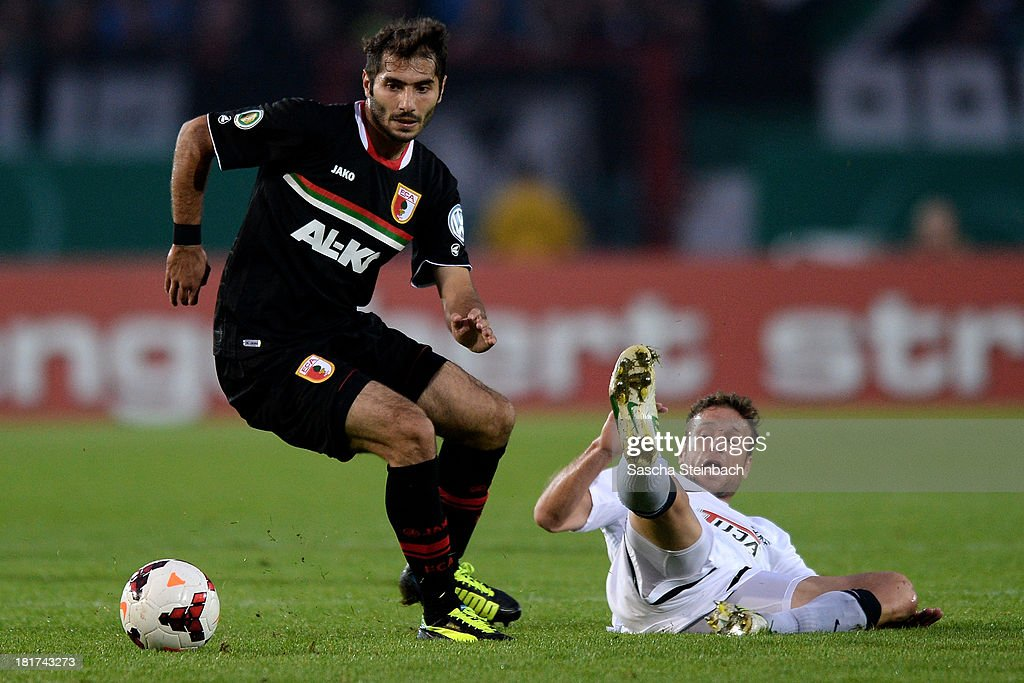 <a gi-track='captionPersonalityLinkClicked' href=/galleries/search?phrase=Halil+Altintop&family=editorial&specificpeople=602238 ng-click='$event.stopPropagation()'>Halil Altintop</a> of FC Augsburg vies with Stefan Kuehne of Preussen Muenster during DFB Cup second round match between Preussen Muenster and FC Augsburg at Preussenstadion on September 24, 2013 in Muenster, Germany.