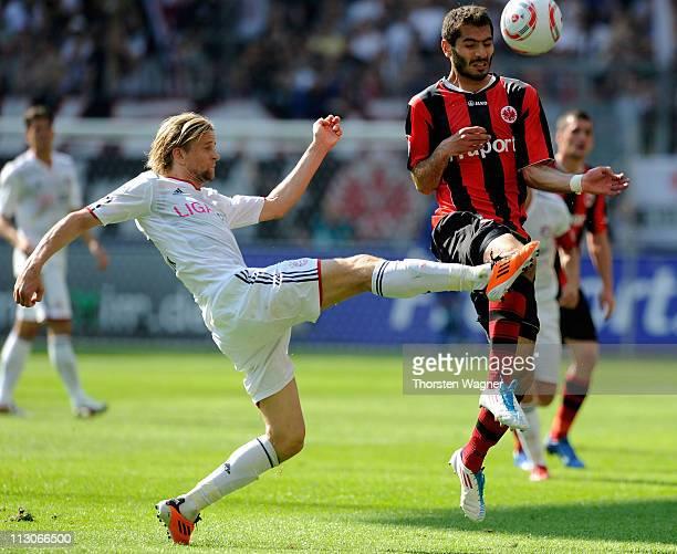Halil Altintop of Frankfurt battles for the ball with Anatoliy Tymoshchuk of Muenchen during the Bundesliga match between Eintracht Frankfurt and FC...