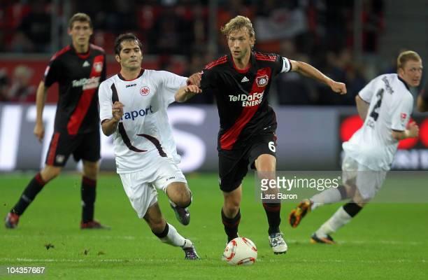Halil Altintop of Frankfurt challenges Simon Rolfes of Leverkusen during the Bundesliga match between Bayer Leverkusen and Eintracht Frankfurt at...