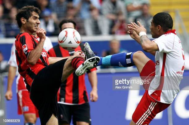 Halil Altintop of Frankfurt is challenged by Paolo Guerrero of Hamburgduring the Bundesliga match between Eintracht Frankfurt and Hamburger SV at the...