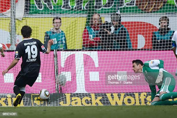 Halil Altintop of Frankfurt scores his teams first goal against Diego Benaglio of Wolfsburg during the Bundesliga match between VfL Wolfsburg and...