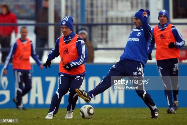 Halil Altintop tackles Alexander Baumjohann of Schalke during the training session of FC Schalke at the training ground of the Veltins Arena on...