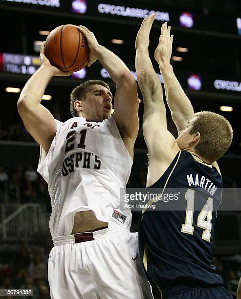 Halil Kanacevic of the Saint Joseph's Hawks goes up for a shot against Scott Martin of the Notre Dame Fighting Irish during their first round game of...